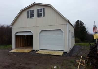 Two story gambrel with dual garages.